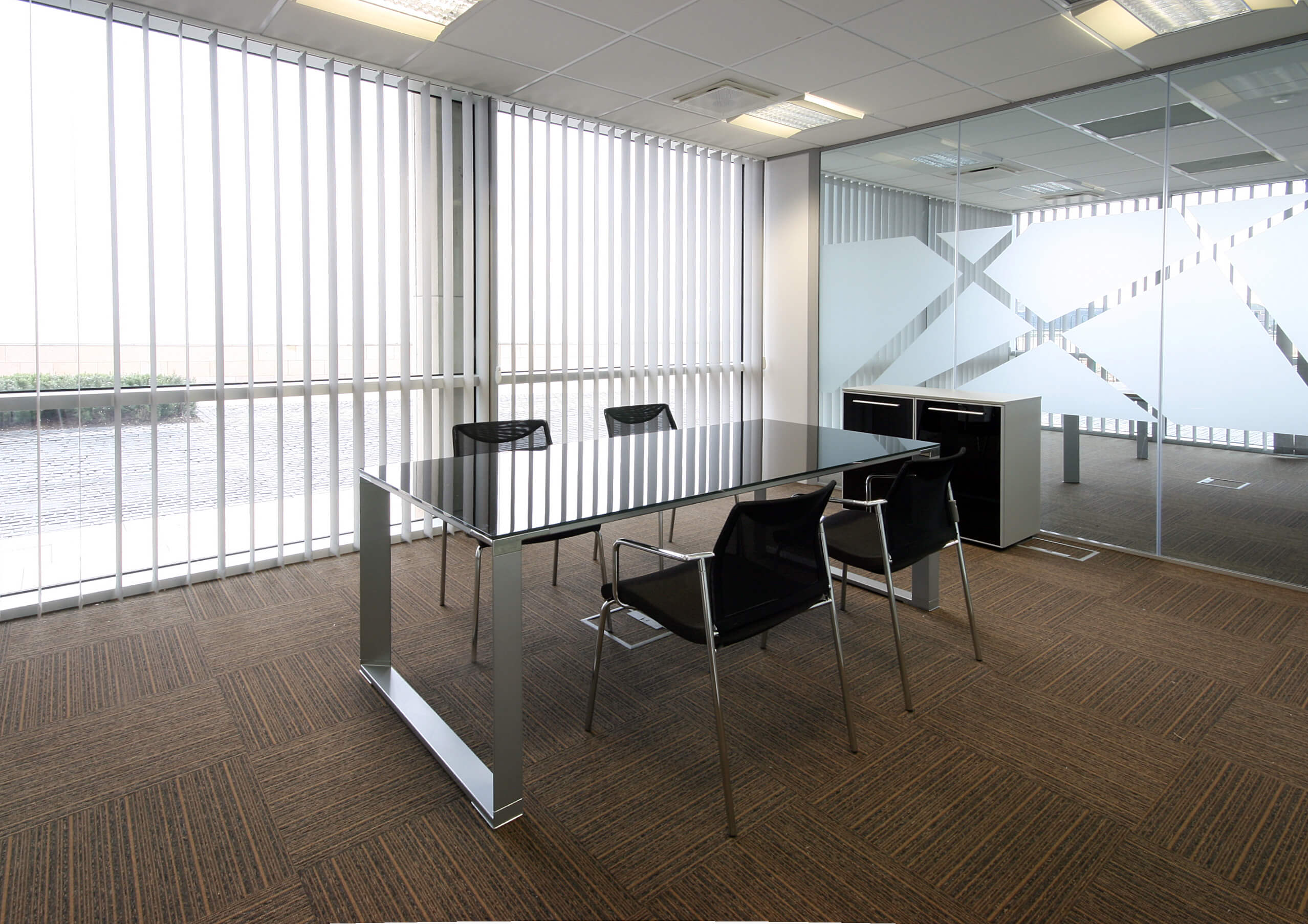 Empty office with vertical blinds